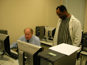 Drs. Bump and Ndip working in the Computer LAb
