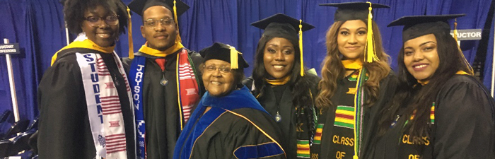 Dr. Willie Darby poses with five graduates in full ceremonial regalia duing the HU 149th Annual Commencement. The students names are listed below.