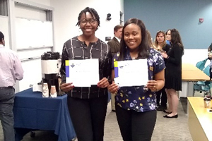 Two young women pose with ACS Awards in hand.