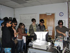 Dr. Hömmerich demonstrates to Spratley students basic principles of light, optics, and lasers.